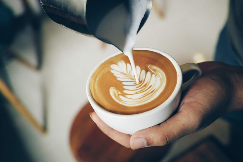 Pouring steamed milk into a cappuccino or latte