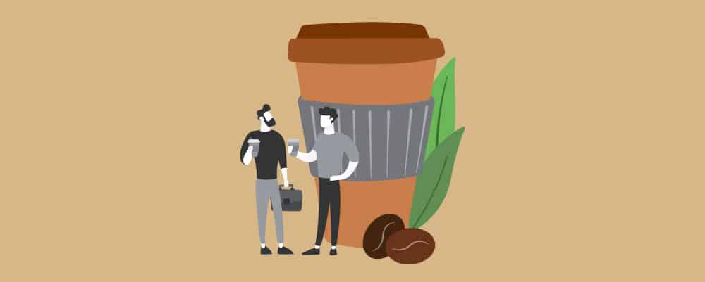 Two men Talking beside a giant cup of coffee